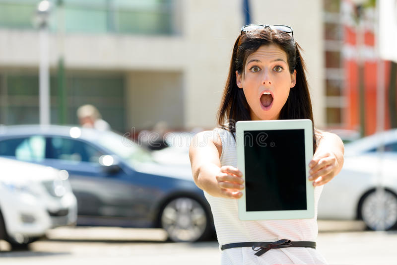 Amazed car sales woman stock photo