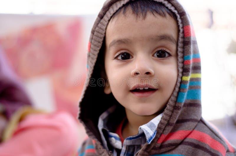 Amazed child. A boy child amazed while looking at something new royalty free stock image