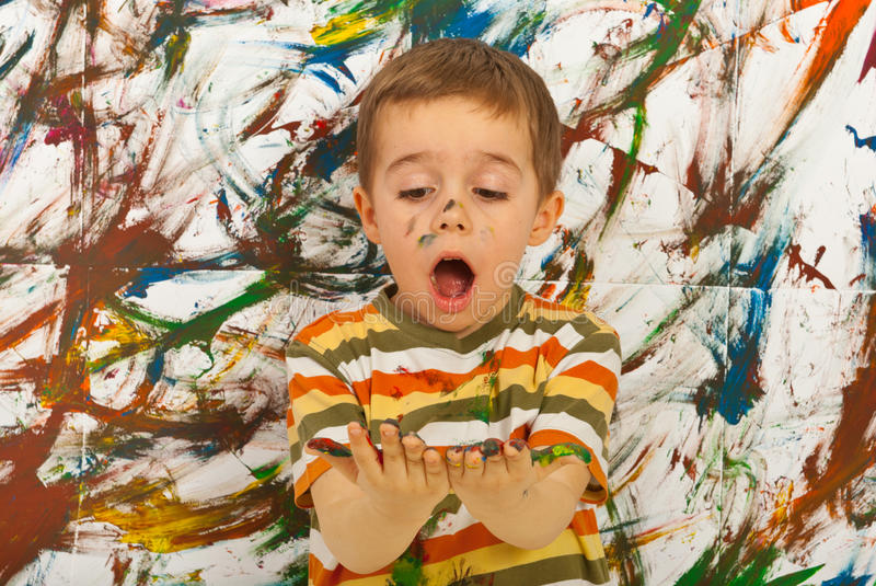 Amazed child looking at messy palms stock photography
