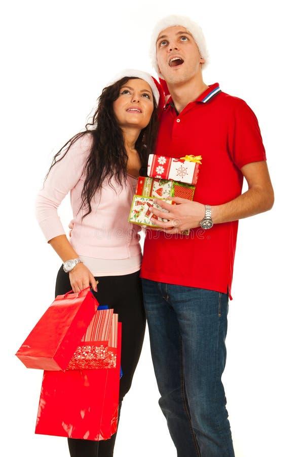Amazed Christmas Couple Looking Up Royalty Free Stock Image