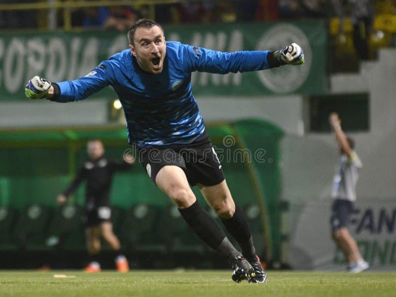 Amazed football goalkeeper stock image
