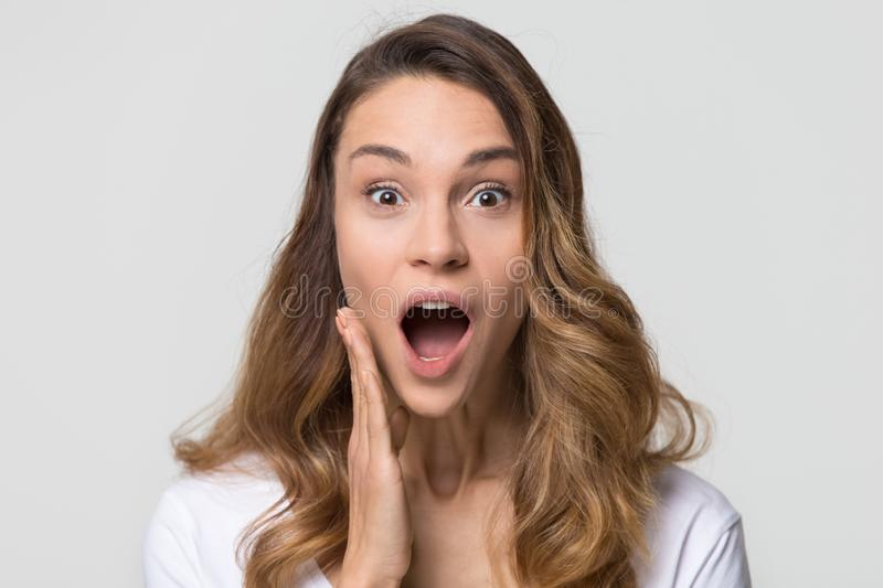 Amazed funny young woman with surprised face looking at camera. Amazed funny young woman girl with surprised wow face open mouth stunned looking at camera stock images