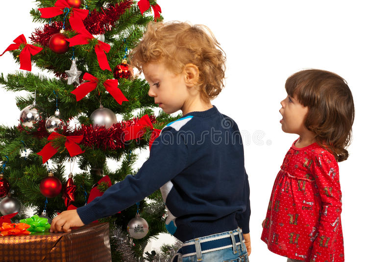 Amazed Girl And Boy With Christmas Tree Royalty Free Stock Images
