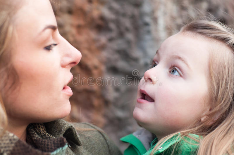 Amazed Little Girl On Mother S Hands Stock Photos