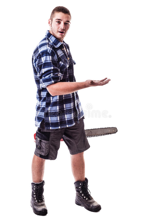 Amazed Lumberjack. A young lumberjack wearing a checkered shirt holding a chainsaw and showing something isolated over white background royalty free stock photos
