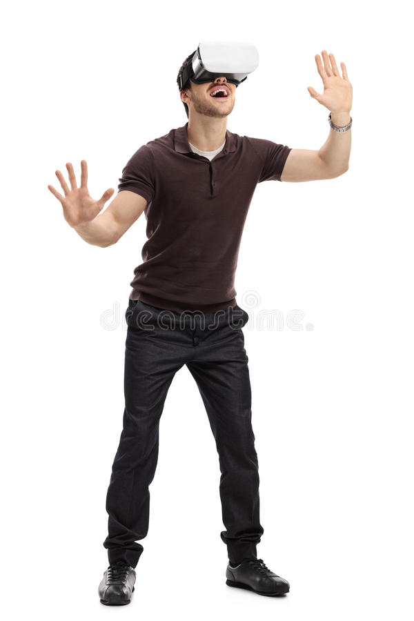 Amazed man experiencing virtual reality through a headset royalty free stock image