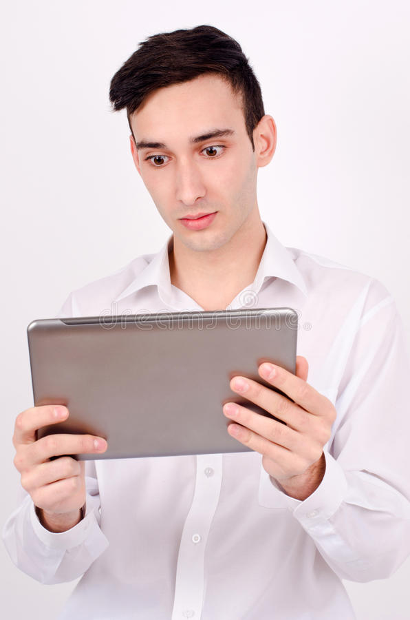Download Amazed Man Reading From A Tablet. Stock Image - Image: 33240495