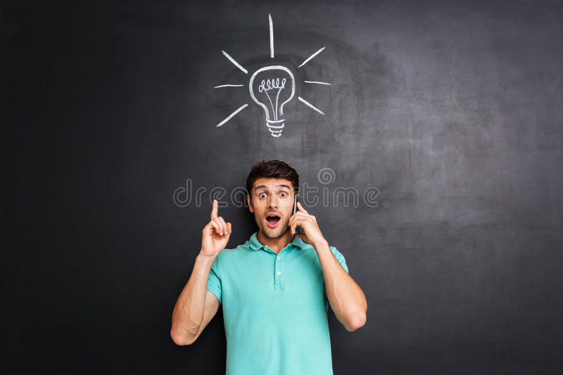 Amazed man talking on cell phone and having an idea royalty free stock photos