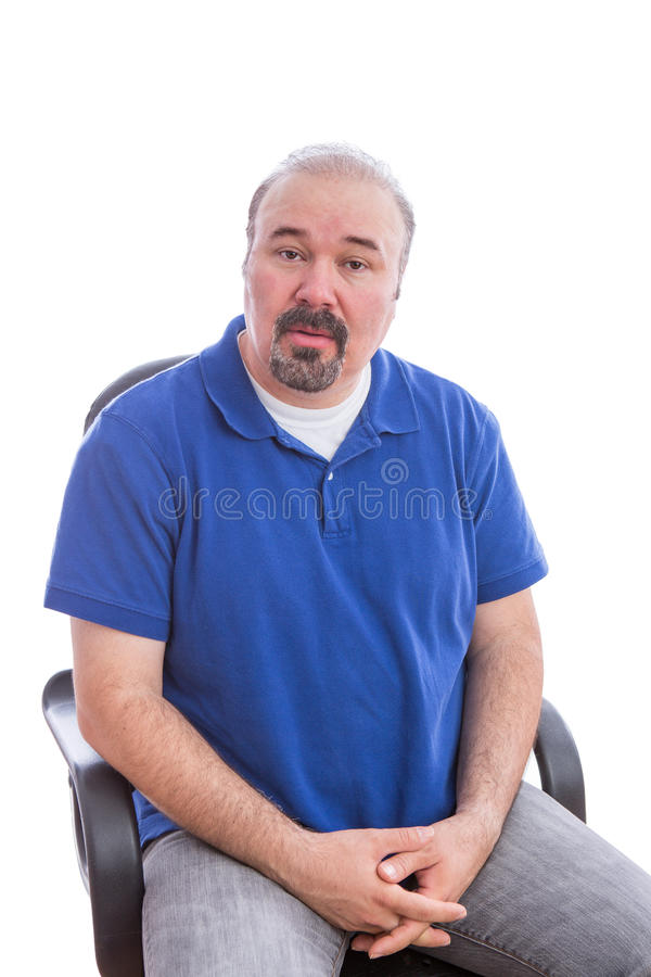 Amazed Middle Age Man Sitting on a Chair stock photo