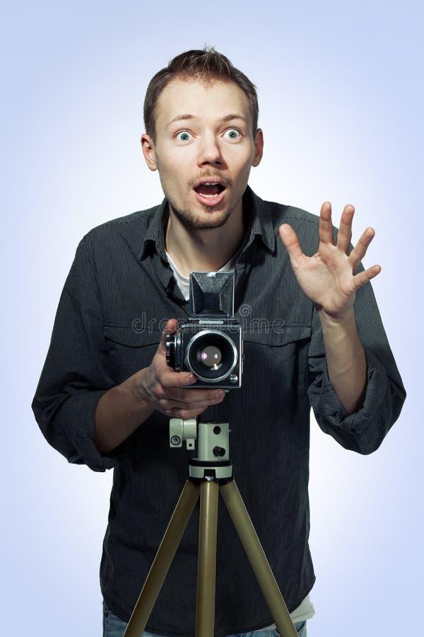 Amazed Photographer With Retro Camera Royalty Free Stock Images