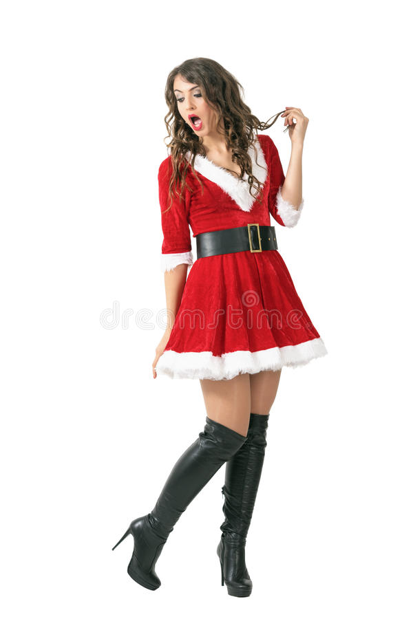 Amazed Santa girl with mouth open looking back over the shoulder stock image
