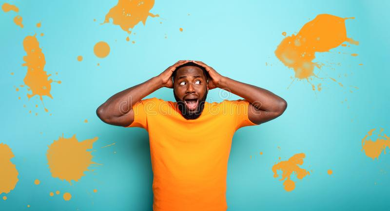 Amazed and shocked expression of a boy over cyan background royalty free stock photo