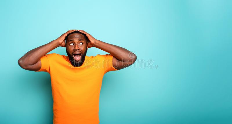 Amazed and shocked expression of a boy over cyan background royalty free stock images