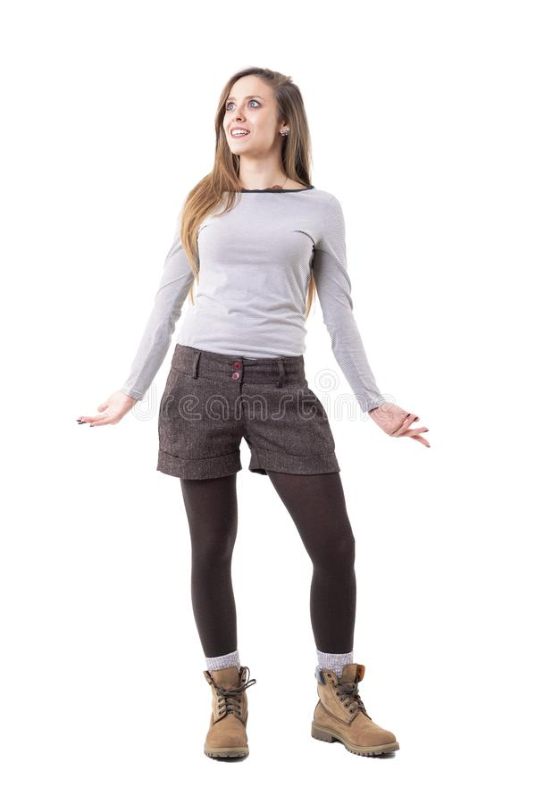 Amazed surprised young happy expressive woman in stylish clothes looking up in disbelief. stock photo