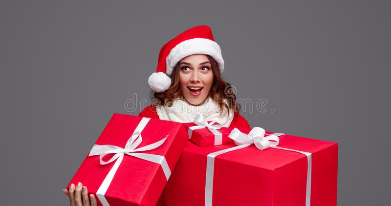 Amazed woman with bunch of Christmas gifts stock photography