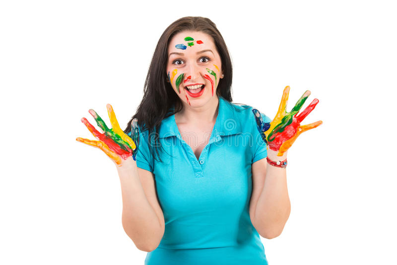 Amazed Woman With Hands In Paints Stock Photo