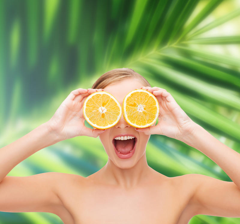 Download Amazed Young Woman With Orange Slices Stock Image - Image of beautiful, green: 37714379