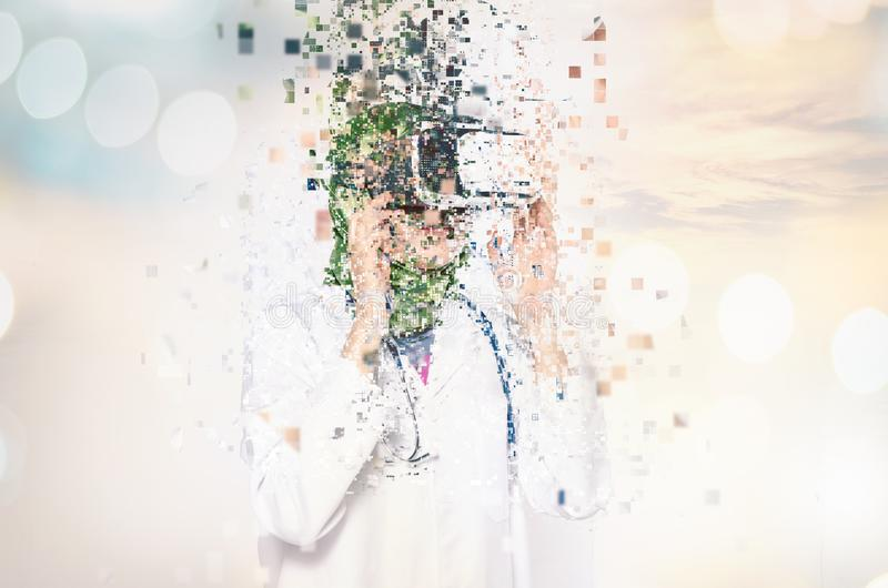 Amazed young women wearing virtual reality goggles dispersing in. Amazed young woman wearing virtual reality goggles dispersing into pixels effect over abstract royalty free stock image