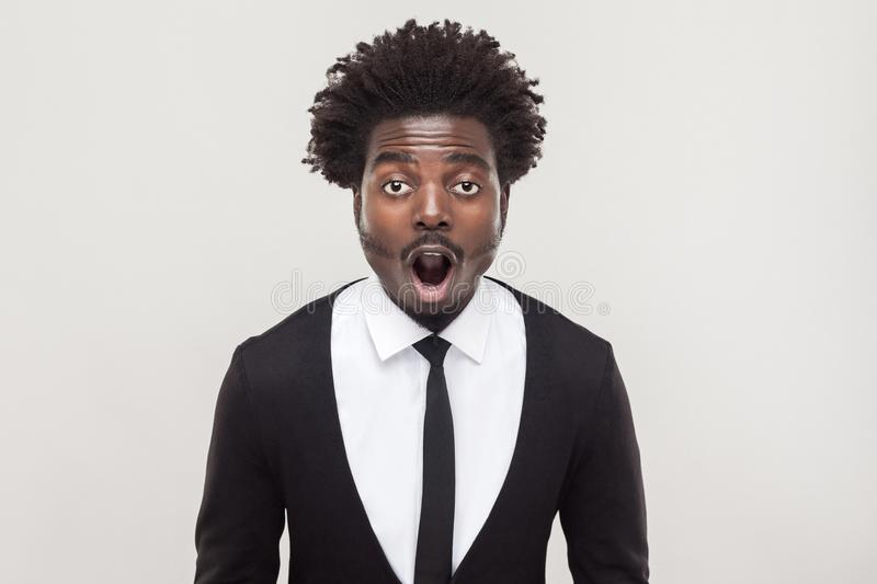 Amazement businessman looking at camera with shocked face. royalty free stock photos