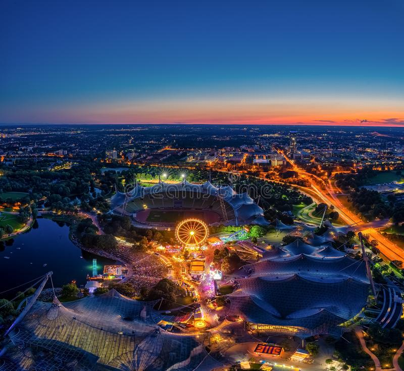 Amazing aerial view at Munichs Olympic park at night with many colored lights from a festival. royalty free stock photo