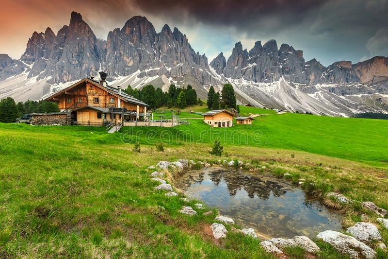 Spectacular alpine chalets with mountain lake in Dolomites, Italy, Europe royalty free stock photography