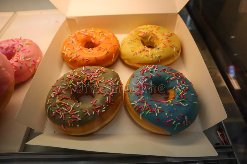 Amazing american colorful doughnuts in chinese bakery royalty free stock images