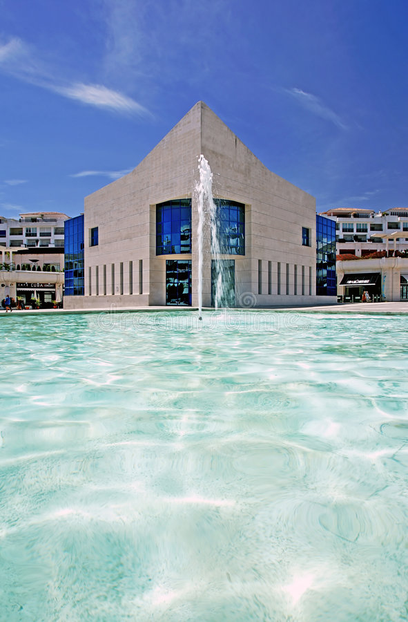 Amazing architecture of modern building next to pond with fountain royalty free stock images