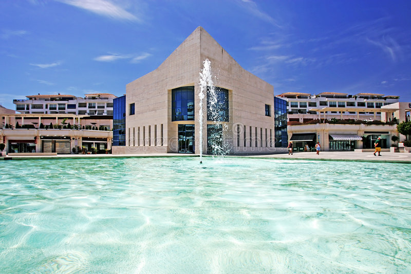 Amazing architecture of modern building next to pond with fountain stock photo