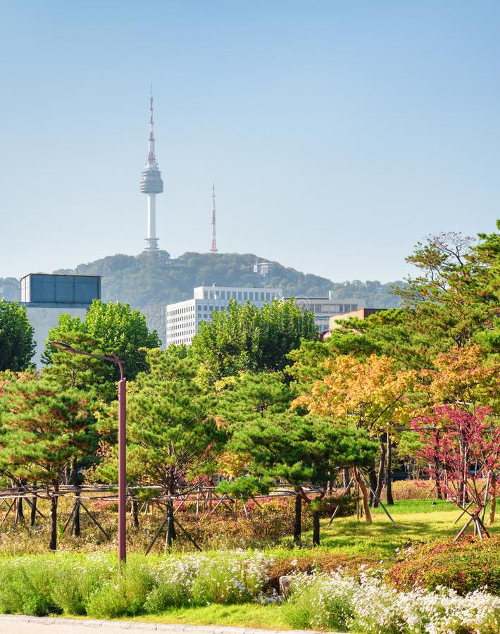 Amazing autumn park in Seoul, South Korea. Namsan Seoul Tower. Amazing colorful autumn park in Seoul, South Korea. Namsan Seoul Tower is visible on blue sky stock photography