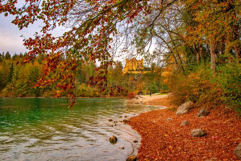 Amazing autumn scenery with Hohenschwangau castle and Alpsee Lake, Bavaria, Germany. Amazing autumn scenery with Hohenschwangau castle, Alpsee Lake and fallen royalty free stock photos