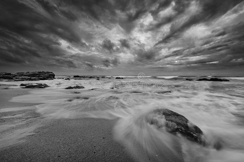 Download amazing beach scene in black and white stock photo image of seashore horizon