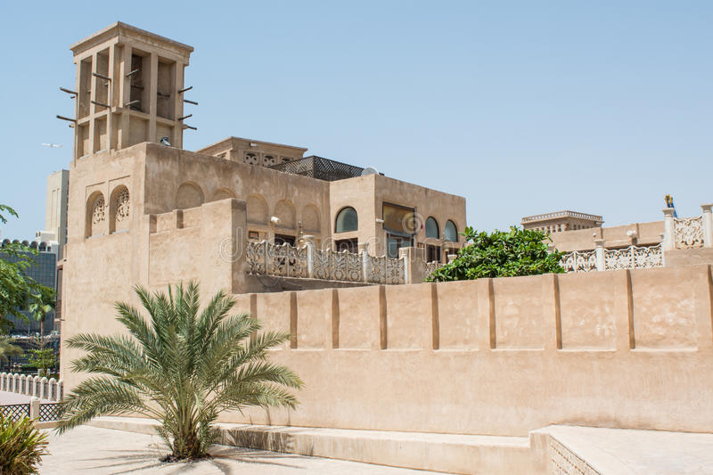 Amazing beautiful ancient historical creamy brown building with bush near by. In the UAE royalty free stock photos