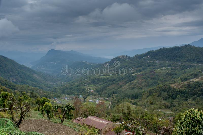Amazing beautiful green wide valley view landscape among mountains covered with trees under cloudy sky royalty free stock images