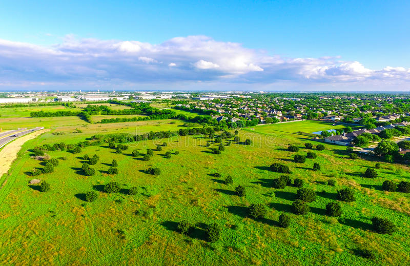 Amazing Bird`s eye view over Ranch farm land in Texas Hill Country Austin Texas. With gorgeous colors and bright Summer landscape. Subruban homes in the royalty free stock photography