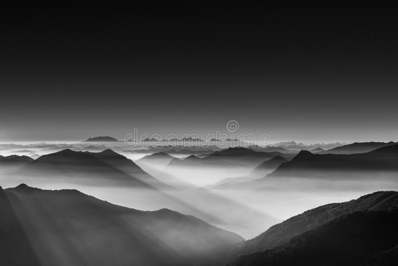 Amazing black and white photography of beautiful mountains and hills with dark skies royalty free stock photo