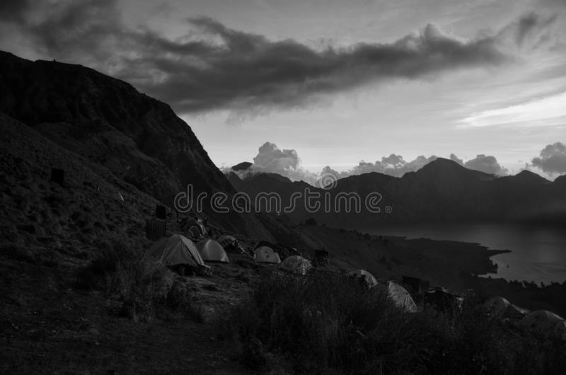 Amazing black & white tent on the rim of the mount Rinjani or Gunung Rinjani. The mount rinjani is an active volcano in indonesia. stock photo