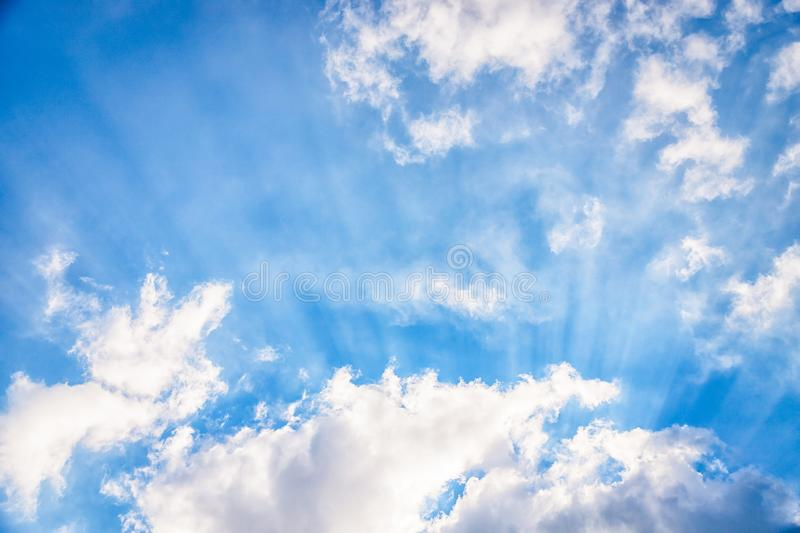 Amazing blue sky with fluffy clouds and sun rays. Beam of light, sky background royalty free stock photos