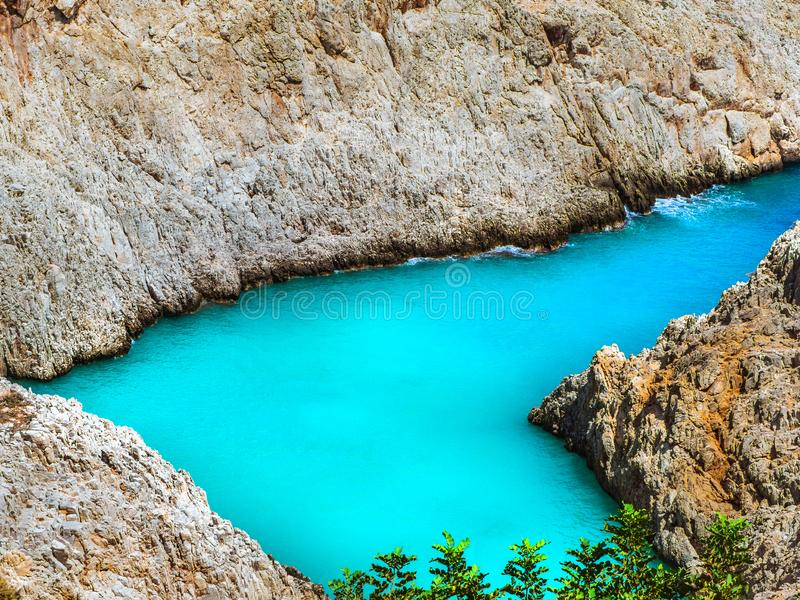 Amazing blue water of a secluded cove beach in Crete, Greece - Seitan Limania Beach royalty free stock images