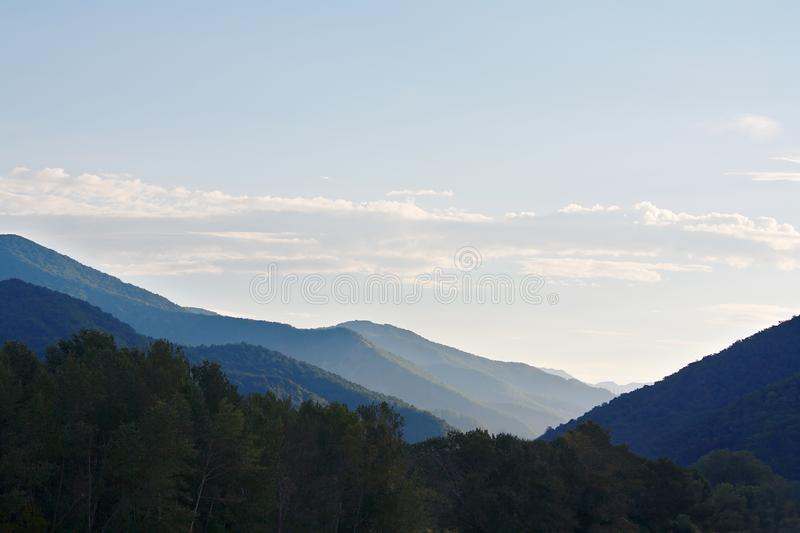 Amazing break of day in mountains covered with forests stock photo
