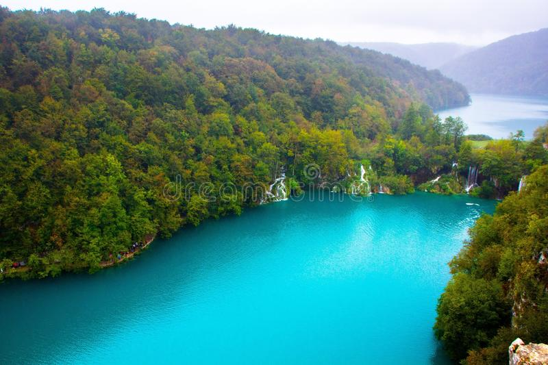 Amazing breathtaking landscape in Plitvice National Park, Croatia. Lakes and waterfalls in forest. Crystal clear azure blue water royalty free stock photo