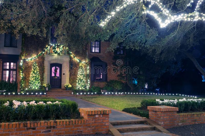 Amazing brick house with his christmas lights. Winter, Night, Ho royalty free stock photography