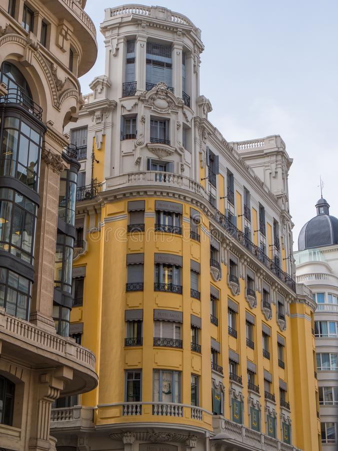 Amazing buildings at Gran Via street in Madrid stock images