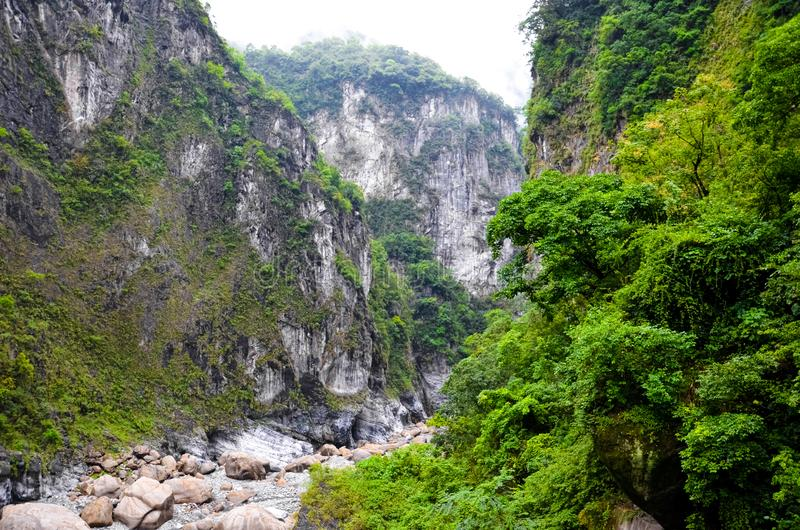 Amazing chinese nature in Taroko National Park, Taiwan. Taroko Gorge is a popular taiwanese tourist spot. Steep rocks along river. Surrounded by tropical forest stock image