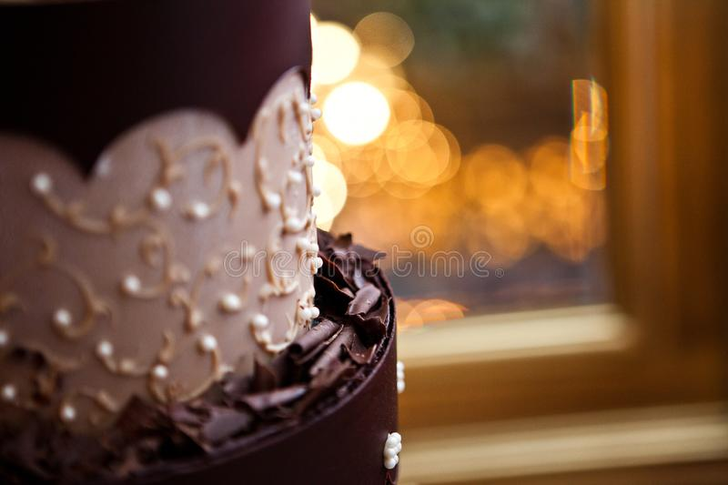 Amazing chocolate cake with candles in the background. Amazing chocolate cake with bokey candles in the background on a wedding day stock images