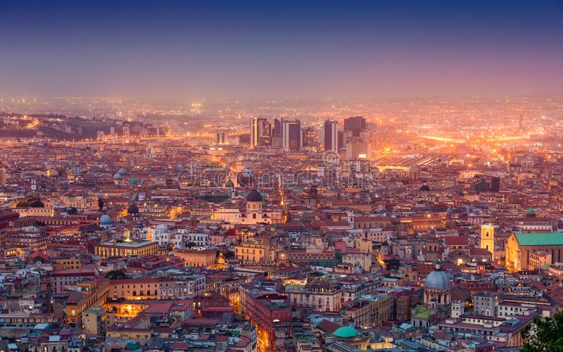 Aerial night view of glowing streets of Naples, Italy. Amazing cityscape - aerial night view of glowing streets of Naples, Italy stock image