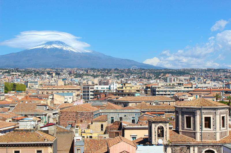 Amazing cityscape of Sicilian city Catania, Italy captured with majestic Etna volcano in the background. Snow on the very top of royalty free stock photos
