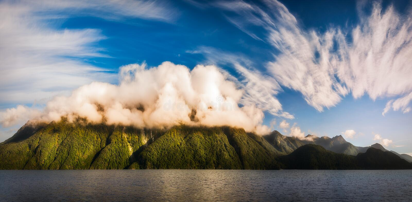 Amazing cloud formation at Lake Manapouri in New Zealand stock images