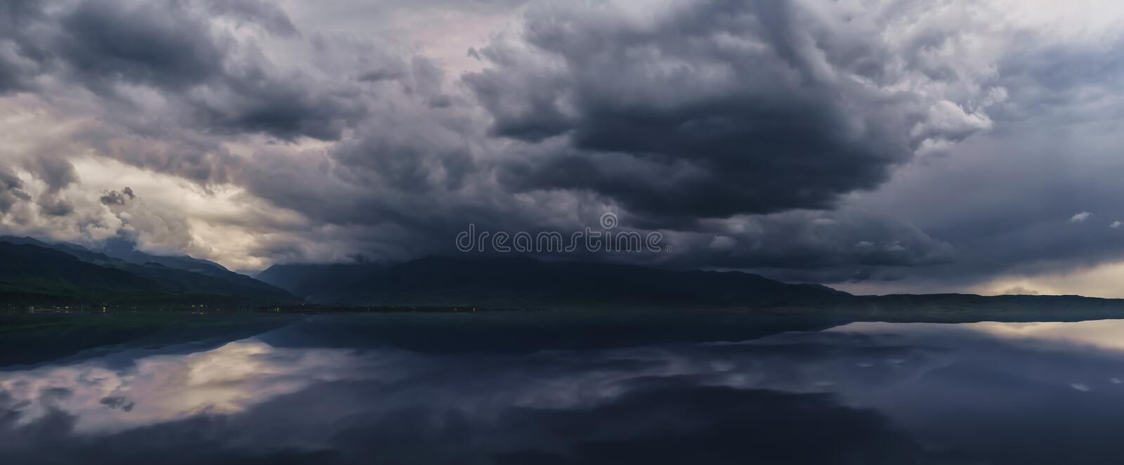Amazing cloud over the mountains. dramatic storm over the lake and mountains. Hiking Adventure stock photography