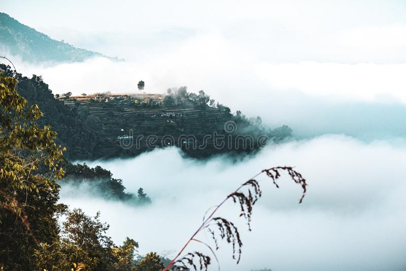 Amazing cloud patterns and view in the village stock photography