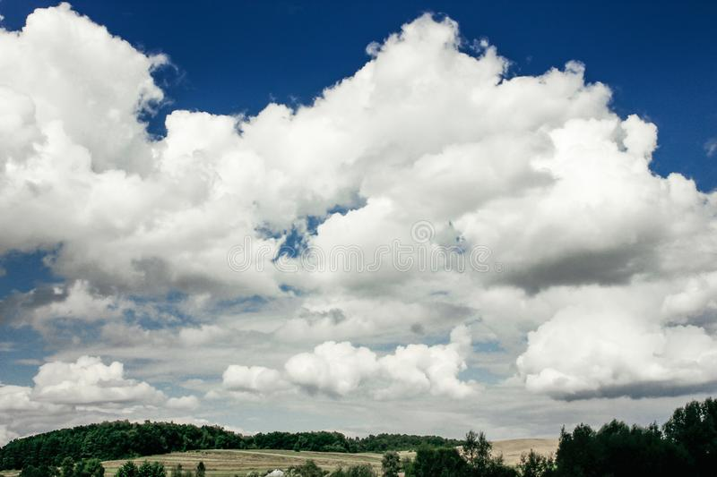 Amazing clouds on blue sky and country side, beautiful summer na. Ture landscape royalty free stock photo